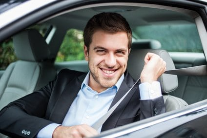 Portrait of an handsome man on his car