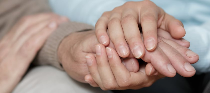 holding hands with an elderly family member